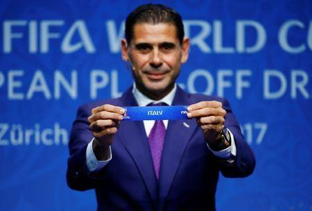 Soccer Football - FIFA World Cup European Play-Off Draw - Zurich, Switzerland - October 17, 2017 Former Spanish player Fernando Hierro displays the name 'Italy' during the draw REUTERS/Arnd Wiegmann
