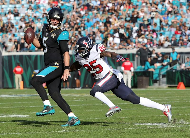 Jaguars quarterback Blake Bortles passed for three touchdowns in the first half on the way to thumping the Houston Texans 45-7 (AFP Photo/SAM GREENWOOD)