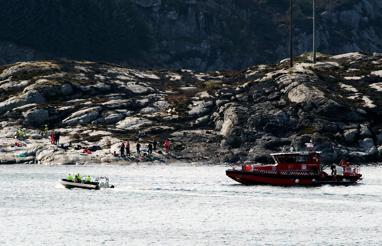 Rescuers work at a site where a helicopter has crashed west of the Norwegian city of Bergen April 29, 2016. NTB Scanpix/Marit Hommedal/via REUTERS ATTENTION EDITORS - THIS IMAGE WAS PROVIDED BY A THIRD PARTY. FOR EDITORIAL USE ONLY. NOT FOR SALE FOR MARKETING OR ADVERTISING CAMPAIGNS. THIS PICTURE IS DISTRIBUTED EXACTLY AS RECEIVED BY REUTERS, AS A SERVICE TO CLIENTS. NORWAY OUT. NO COMMERCIAL OR EDITORIAL SALES IN NORWAY. NO COMMERCIAL SALES.