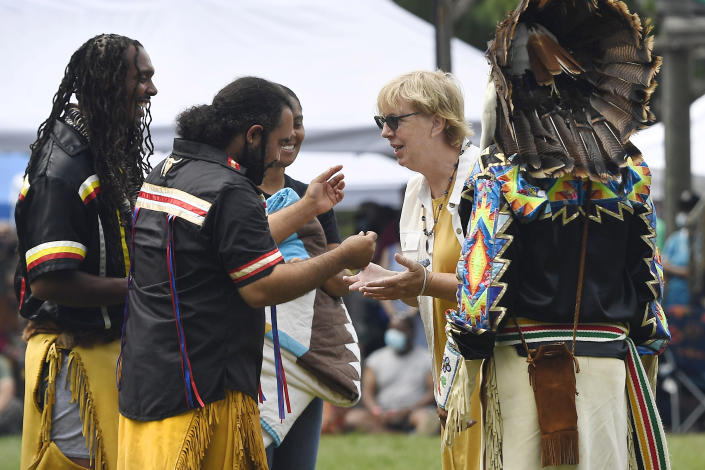 Connecticut State Sen. Cathy Osten, D-Sprauge, receives a necklace as a gift from representatives of the Pequot Nation for her support of Native Americans at Schemitzun on the Mashantucket Pequot Reservation in Mashantucket, Conn., Saturday, Aug. 28, 2021. Osten proposed a bill to add Native American studies to school social studies curriculums. (AP Photo/Jessica Hill)