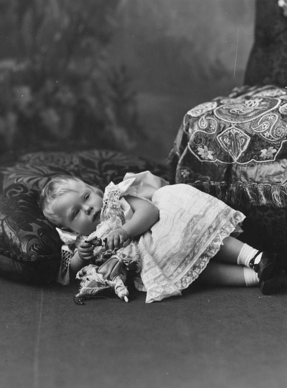 <p>Edward, the eldest son of King George V and Queen Mary, is photographed resting on a pillow at around 6 months old. In 1936, Edward officially became King Edward VIII but abdicated the throne in less than one year so he could marry American divorcée Wallis Simpson. Edward's brother, King George VI, took over the throne, while Edward became the Duke of Windsor.</p>