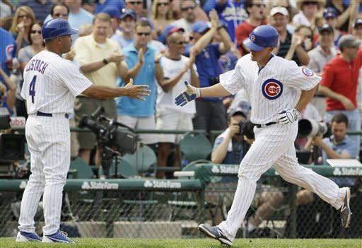 Chicago Cubs' Steve Clevenger, right, celebrates with third base coach Pat Listach after hitting a two-run home run during the fourth inning of a baseball game against the Houston Astros in Chicago, Friday, June 29, 2012. (AP Photo/Nam Y. Huh)