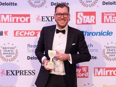 James Clarke, General Manager of Travelzoo in the UK, receives the British Travel Award.