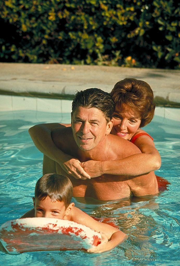 <p>The young family—Ronald, Nancy, and Ron Jr.—swam in the pool at their Santa Barbara, CA ranch. </p>
