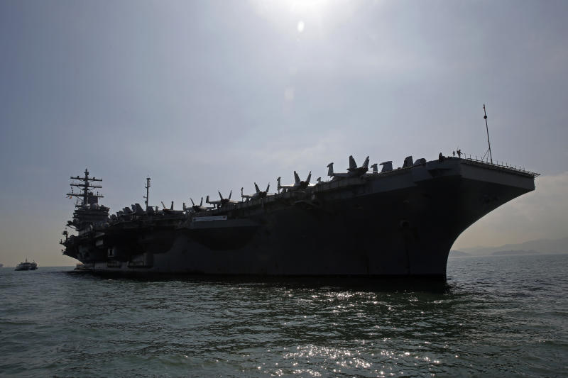 The U.S. Navy's USS Ronald Reagan aircraft carrier is anchored In Hong Kong, Wednesday, Nov. 21, 2018. The USS Reagan docked in Hong Kong on Wednesday, days after a pair of American B-52 bombers flew over the disputed South China Sea. (AP Photo/Kin Cheung)
