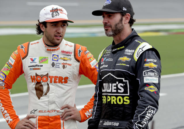"<a class=""link rapid-noclick-resp"" href=""/nascar/truck/drivers/3311"" data-ylk=""slk:Chase Elliott"">Chase Elliott</a>, left, and Jimmie Johnson talk on pit road during qualifying for the NASCAR Cup Series auto race at Daytona International Speedway, Friday, July 6, 2018, in Daytona Beach, Fla. (AP Photo/John Raoux)"