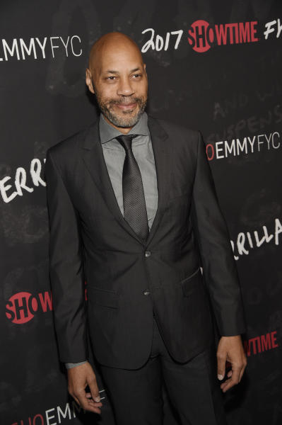 """FILE - In this April 13, 2017 file photo, John Ridley, executive producer of """"Guerrilla,"""" poses at a """"For Your Consideration"""" event for the Showtime series at the Writers Guild of America in Beverly Hills, Calif. Ridley is one of six filmmakers who have documentaries about the 1992 Los Angeles riots. The films are being released to mark the 25th anniversary of the most destructive civil disturbance in US history. (Photo by Chris Pizzello/Invision/AP, File)"""