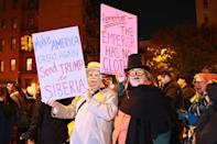 <p>People wear political costumes and carry anti-Trump placards in the 44th annual Village Halloween Parade in New York City on Oct. 31, 2017. (Photo: Gordon Donovan/Yahoo News) </p>