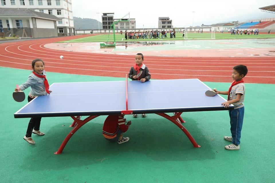 Children play table tennis during their break at Wenchang Primary School in Liangshan prefecture, home to the largest community of ethnic Yi people in China. Photo: Simon Song