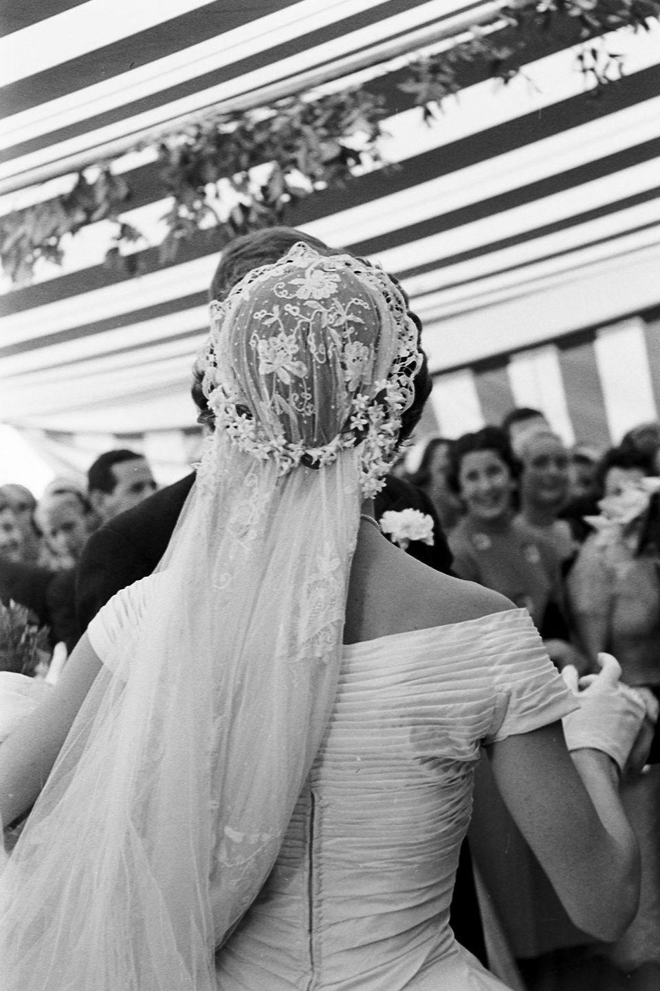 <p>Jackie wore a lace veil that belonged to her grandmother.</p>