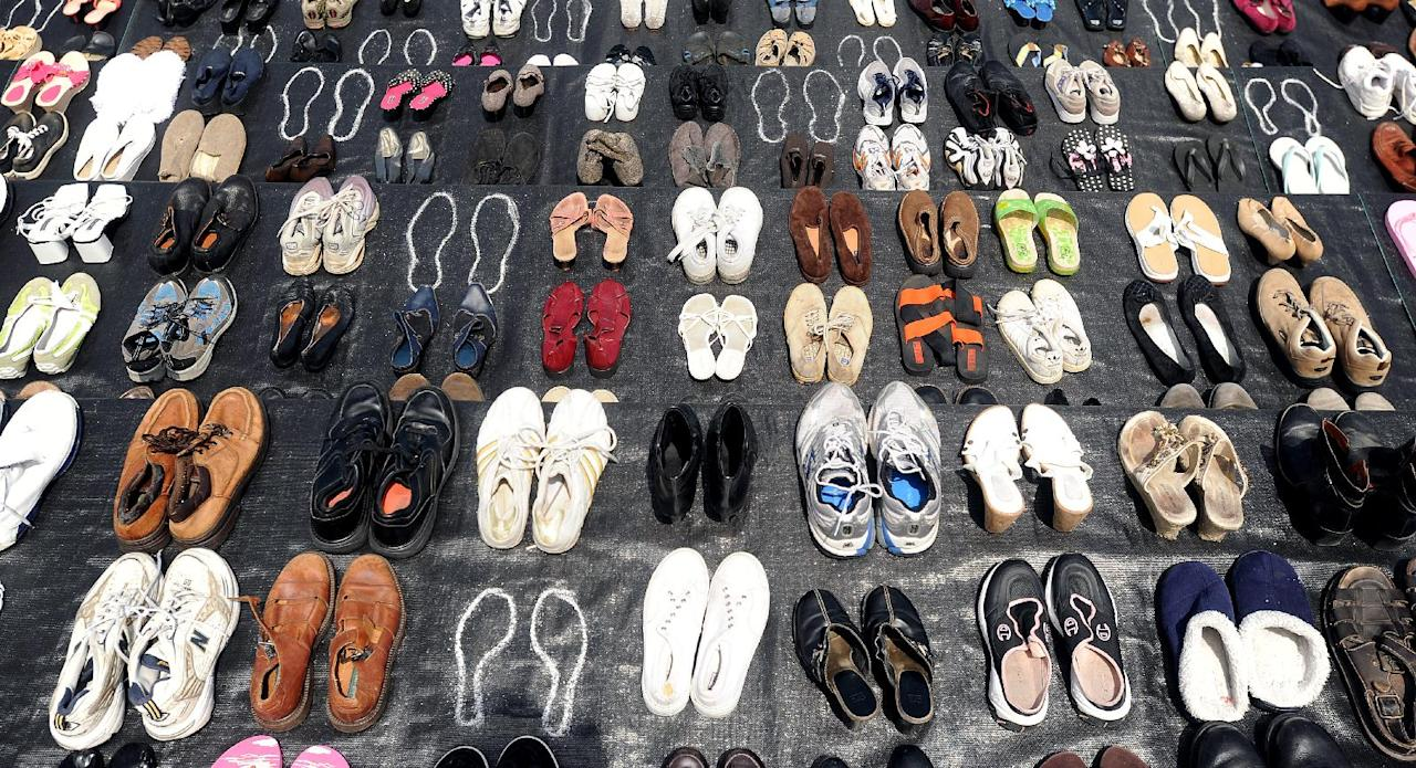An exhibit of shoes in remembrance of people who have jumped from the Golden Gate Bridge is displayed during a commemoration of the bridge's 75th anniversary on Sunday, May 27, 2012, in San Francisco. The Bridge Rail Foundation, which advocates for a safety net along the span to prevent suicides, estimates approximately 1,558 people have died after jumping since the bridge opened. (AP Photo/Noah Berger)