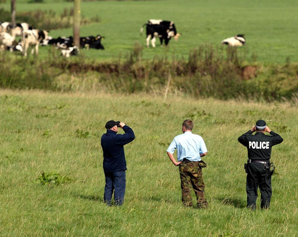 Police search fields in North Antrim, Belfast, following sightings of a big cat. The search follows more than 20 sightings of a wild animal, thought to be a puma, in the area since August. A helicopter and police air support unit is also involved in a dawn till dusk operation to try to catch or kill the animal.   (Photo by Paul Faith - PA Images/PA Images via Getty Images)