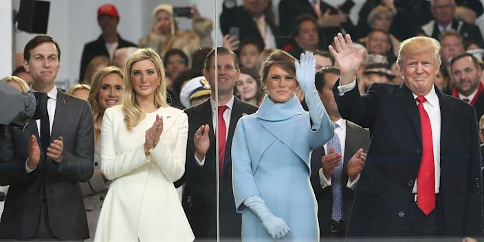 President Donald Trump waving with his family inside the inaugural parade reviewing stand in front of the White House on January 20, 2017 in Washington, DC.