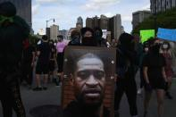 Protest against the death in Minneapolis police custody of African-American man George Floyd and the assault of Sha'Teina and Dan Grady El by Washtenaw County police, in Detroit