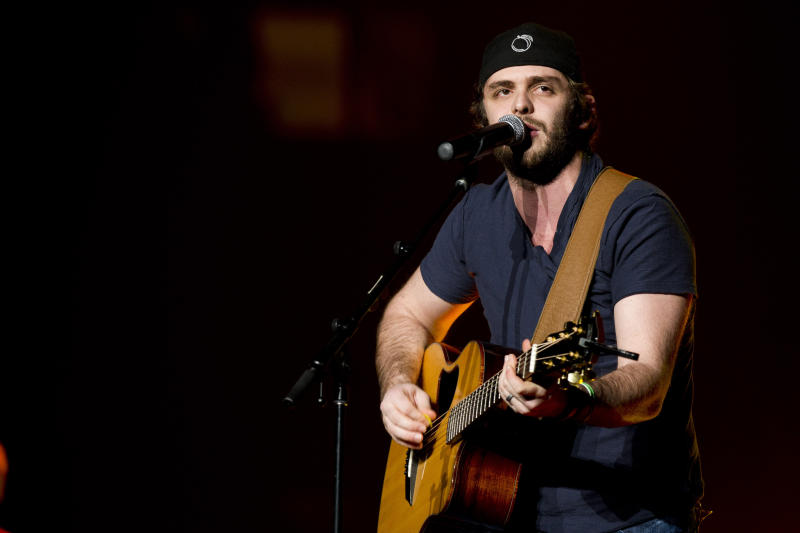 FILE - In this March 2, 2013 file photo, Thomas Rhett opens for Jason Aldean at Madison Square Garden, in New York. Growing up watching his father, Rhett Akins, on tour gave the 23-year-old Thomas Rhett some insight at a young age about how to deal with nerves and crowds. (Photo by Charles Sykes/Invision/AP, File)