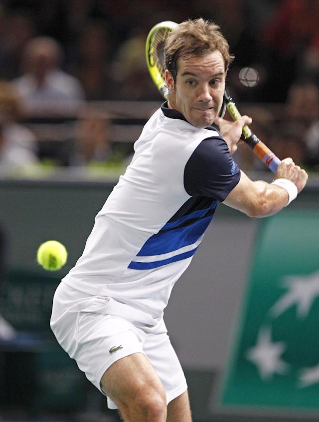 France's Richard Gasquet returns the ball to Spain's Fernando Verdasco, during their second round match, at the Tennis Paris Masters, in the Paris Bercy stadium, Tuesday Oct. 29, 2013.(AP Photo/Remy de la Mauviniere)