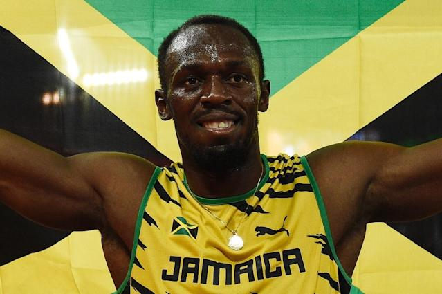 Usain Bolt celebrates victory in the men's 100m in Beijing on August 23, 2015 (AFP Photo/Franck Fife)