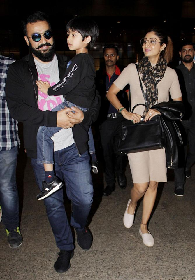 Raj Kundra and Shilpa Shetty with their son Viaan at Mumbai airport while returning from Dubai after celebrating the New Year. (Image: Yogen Shah)
