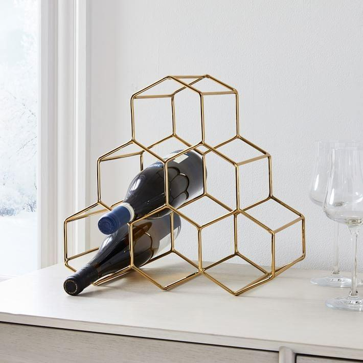 <p>Let's be honest, this <span>Honeycomb Wine Rack</span> ($36, originally $60) is just an excuse to buy more bottles. </p>