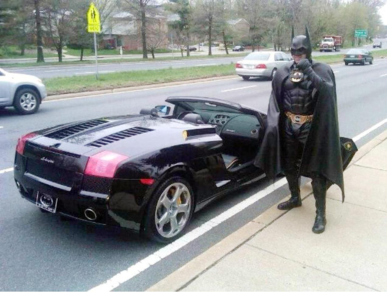 Holy cow Batman! Children's entertainer Lenny Robinson was pulled over by police because he didn't have a proper number plate for his Batmobile - a swish black Lamborghini Gallado. Instead of a licence plate he had a batwing emblem - presumably to let other cars know he was the Caped Crusader. The Batman impersonator was let off with a warning from Maryland police in America (Rex)