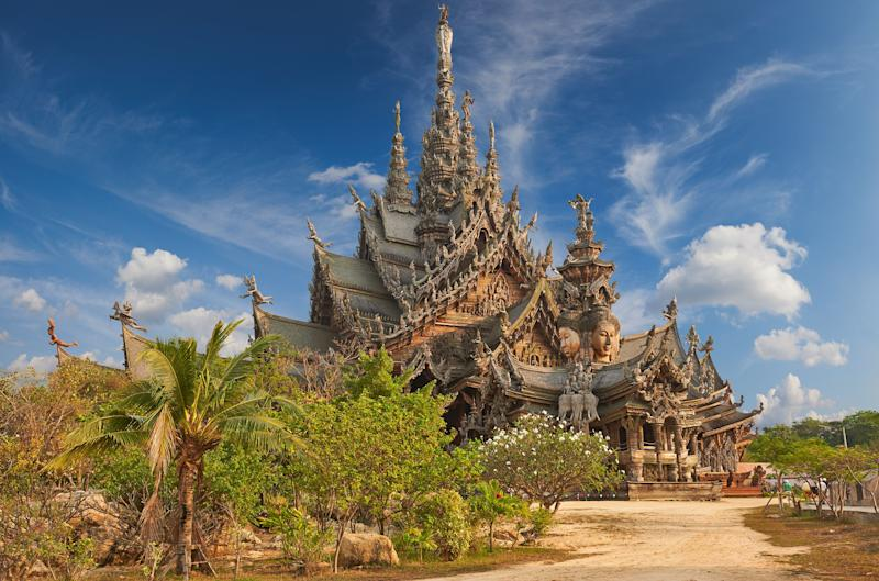 """Thailand's Sanctuary of Truth is an <a href=""""https://www.renown-travel.com/daytripspattaya/sanctuaryoftruth.html"""" target=""""_blank"""">all-wood building</a> filled with sculptures based on traditional Buddhist and Hindu motifs.It is covered in intricate wood carvings, meant to depict complex ideas about ancient thought, human responsibility, and the cycle of life."""