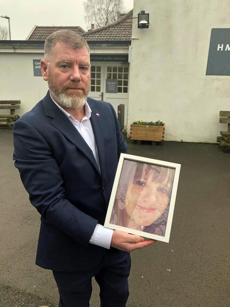 Kevin O'Connor holds a picture of his wife Julie outside Avon coroner's court in Flax Bourton, near Bristol.