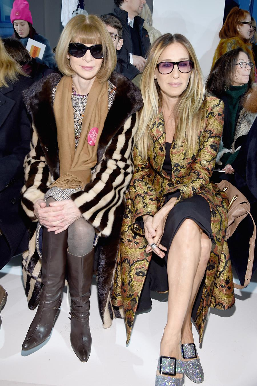 <p>Sarah Jessica Parker cut a stylish figure in a patterned statement coat alongside Vogue editor-in-chief Anna Wintour in the front row. (Photo: Getty Images) </p>