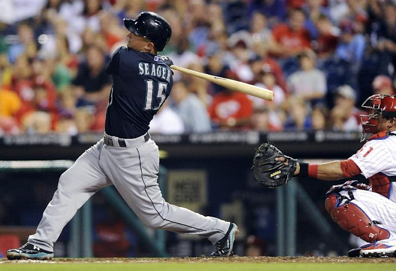 Seattle Mariners' Kyle Seager hits a solo home run to right field in the sixth inning of an interleague baseball game against the Philadelphia Phillies on Tuesday, Aug. 19, 2014, in Philadelphia. (AP Photo/Michael Perez)