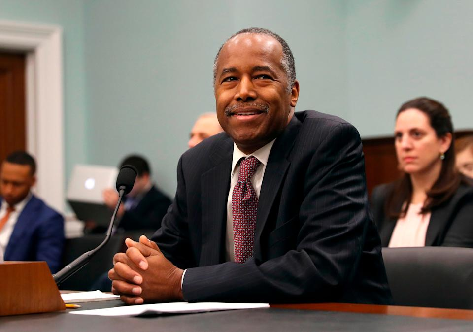 FILE - In this March 20, 2018, file photo, Housing and Urban Development Secretary Ben Carson takes his seat before testifying before a House Committee on Appropriation subcommittee hearing on Capitol Hill in Washington. Millions of families living in federally subsidized public housing would have to pay more for rent under a Trump administration proposal. The Department of Housing and Urban Development is asking Congress to raise the rent paid by public housing residents to 35 percent of income from the current 30 percent. (AP Photo/Pablo Martinez Monsivais, File)