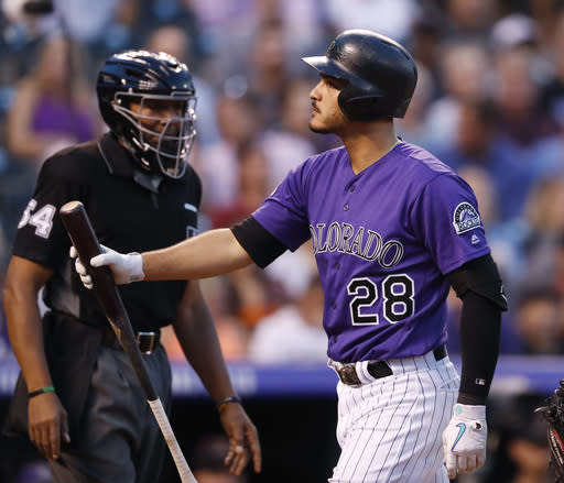 Colorado Rockies' Nolan Arenado, front, reacts after being called out on strikes by umpire CB Bucknor while facing Arizona Diamondbacks starting pitcher Zack Godley in the first inning of a baseball game against the Monday, Sept. 10, 2018, in Denver. (AP Photo/David Zalubowski)