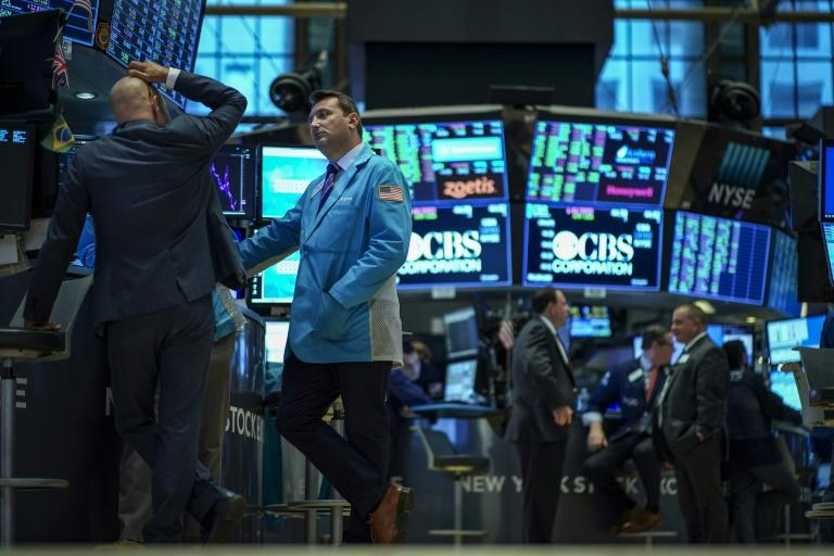 The US stock market got a boost from news that US is delaying enforcement of a ban on Chinese telecoms giant Huawei and improved prospects for US-China trade talks (AFP Photo/Drew Angerer)