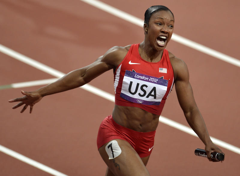 United States' Carmelita Jeter reacts as she crosses the finish line to win the women's 4 x 100-meter relay during the athletics in the Olympic Stadium at the 2012 Summer Olympics, London, Friday, Aug. 10, 2012. The United States relay team set a new world record with a time of 40.82 seconds.(AP Photo/Martin Meissner)