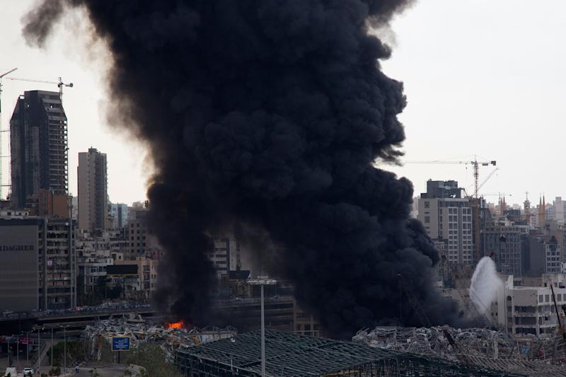 BEIRUT, LEBANON - SEPTEMBER 10: Smoke rises from a fire which has broken out at the Beirut Port on September 10, 2020 in Beirut, Lebanon. The fire broke out in a structure in the city's heavily damaged port facility, the site of last month's explosion that killed more than 190 people. (Photo by Sam Tarling/Getty Images)