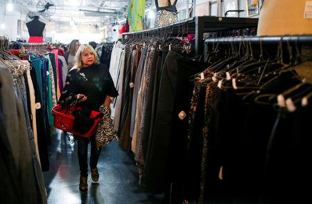 A woman shops in a used clothing shop in Buenos Aires, Argentina May 14, 2019. Picture taken May 14, 2019. REUTERS/Agustin Marcarian