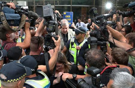FILE PHOTO: Catholic Cardinal George Pell is seen leaving the County Court in Melbourne