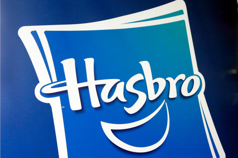 FILE - This April 26, 2018, file photo, shows the Hasbro logo at the TTPM 2018 Spring Showcase, in New York. The critical holiday shopping season, coupled with quarantining amid the ongoing coronavirus pandemic, pushed board game sales up 21% at Hasbro in the fourth quarter. (AP Photo/Richard Drew, File)