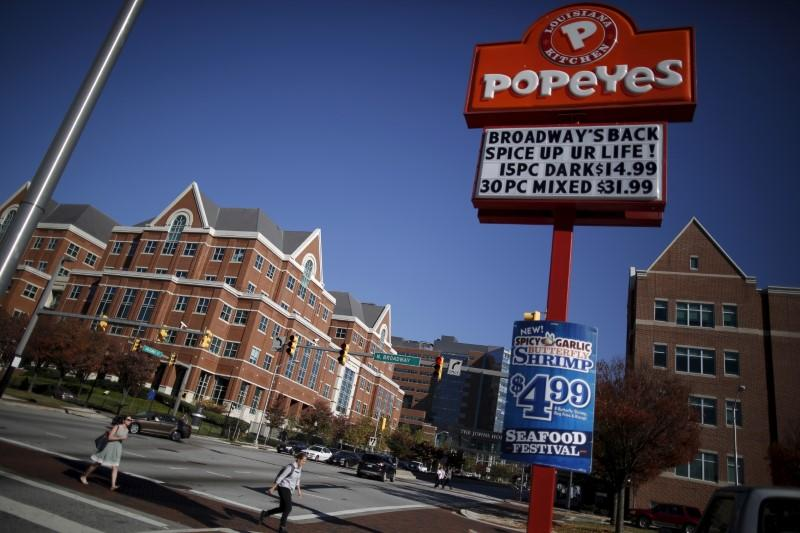 A popeyes restaurant sign is seen on the intersections of Broadway and New Orleans a cross the street from the John Hopkins Hospital in Baltimore, Maryland