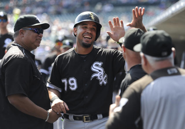 FILE - In this Thursday, Sept. 14, 2017 file photo, Chicago White Sox first baseman Jose Abreu (79) is congratulated in the dugout after scoring a run against the Detroit Tigers in the first inning of a baseball game in Detroit. White Sox slugger Jose Abreu will miss Chicagos three-game series against the Cleveland Indians because of an infection in his right thigh. Manager Rick Renteria says Abreu had the infection cleaned up at a hospital in Cleveland. He says the team will provide an update on Abreu on Friday, Sept. 21, 2018(AP Photo/Jose Juarez, File)