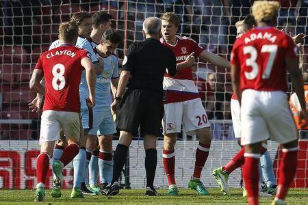 Britain Football Soccer - Middlesbrough v Burnley - Premier League - The Riverside Stadium - 8/4/17 Middlesbrough's Patrick Bamford appeals to the referee Martin Atkinson after being fouled by Burnley's Michael Keane Action Images via Reuters / Craig Brough Livepic