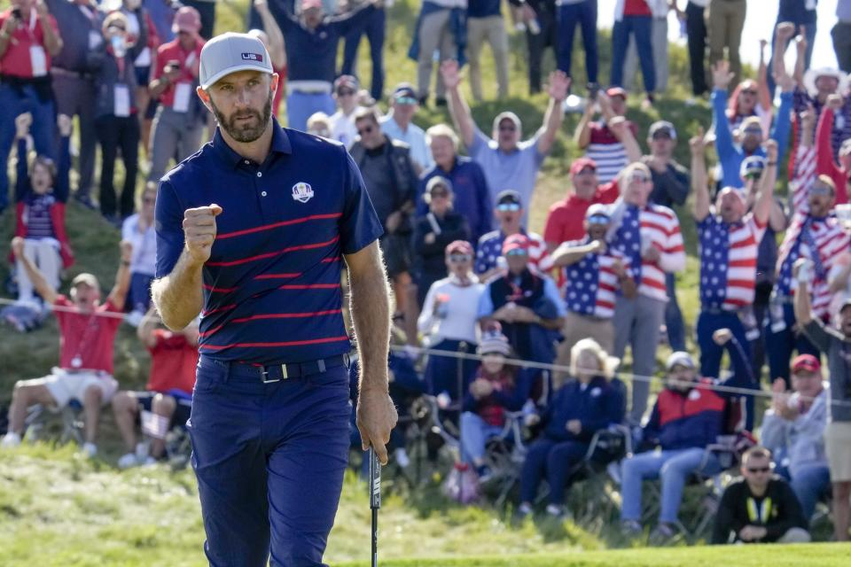 Team USA's Dustin Johnson reacts after winning the 11th hole during a four-ball match the Ryder Cup at the Whistling Straits Golf Course Friday, Sept. 24, 2021, in Sheboygan, Wis. (AP Photo/Ashley Landis)
