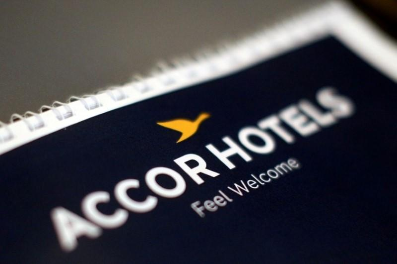 FILE PHOTO: The logos of AccorHotels group is pictured during a news conference at the Pullman Bangkok King Power hotel, in Bangkok, Thailand, June 15, 2017. REUTERS/Athit Perawongmetha/File Photo