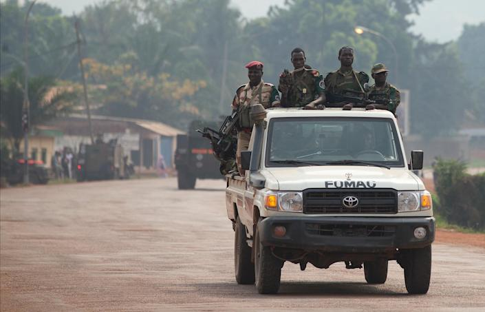 Chadian troops, part of an African Union peacekeeping force, drive down a road in Bangui, Central African Republic, Thursday, Dec. 26, 2013. The spokesman for an African Union peacekeeping force in the Central African Republic says six Chadian peacekeepers were killed and 15 were wounded, after being attacked in the country's chaotic capital Wednesday. The Chadian contingent, which is made up of Arabic-speaking Muslim soldiers, has been accused of taking sides in the country's sectarian conflict. (AP Photo/Rebecca Blackwell)