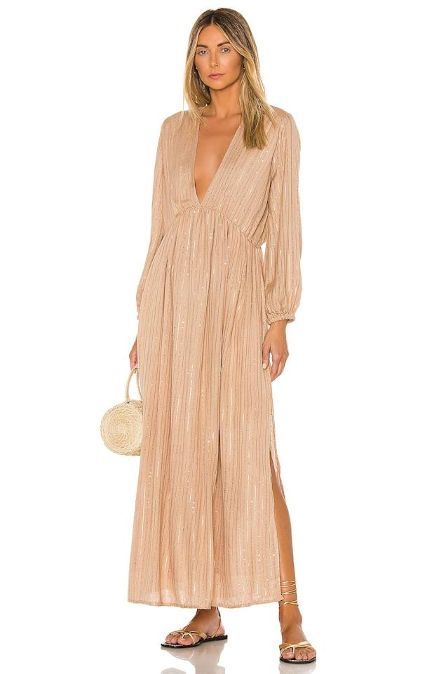 "<p>This shimmering neutral <a href=""https://www.popsugar.com/buy/Sundress-Chicago-Long-Dress-584589?p_name=Sundress%20Chicago%20Long%20Dress&retailer=revolve.com&pid=584589&price=161&evar1=fab%3Aus&evar9=46222295&evar98=https%3A%2F%2Fwww.popsugar.com%2Ffashion%2Fphoto-gallery%2F46222295%2Fimage%2F47590897%2FSundress-Chicago-Long-Dress&list1=shopping%2Cdresses%2Csummer%2Csummer%20fashion&prop13=api&pdata=1"" rel=""nofollow"" data-shoppable-link=""1"" target=""_blank"" class=""ga-track"" data-ga-category=""Related"" data-ga-label=""https://www.revolve.com/sundress-chicago-long-dress/dp/SDRE-WD50/?d=Womens&amp;page=1&amp;lc=70&amp;itrownum=18&amp;itcurrpage=1&amp;itview=05"" data-ga-action=""In-Line Links"">Sundress Chicago Long Dress</a> ($161) is insanely gorgeous.</p>"