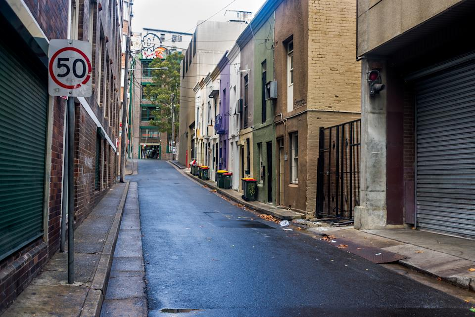 Sydney, Australia - March 13, 2015: A narrow lane in old Surry Hills an area of Sydney known for its cultural and cafe scene.