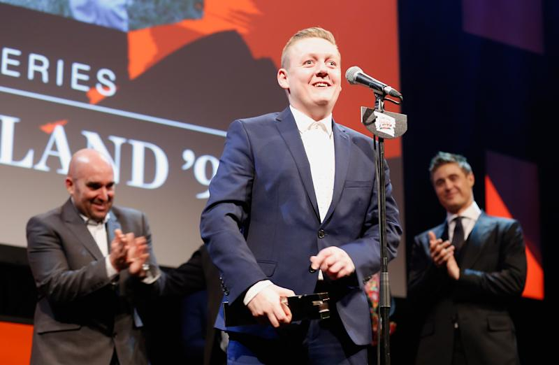 "Thomas Turgoose and the cast of ""This is England 90"" on stage after winning the Best TV Series award during the Jameson Empire Awards 2016. (Photo by Tristan Fewings/Getty Images)"