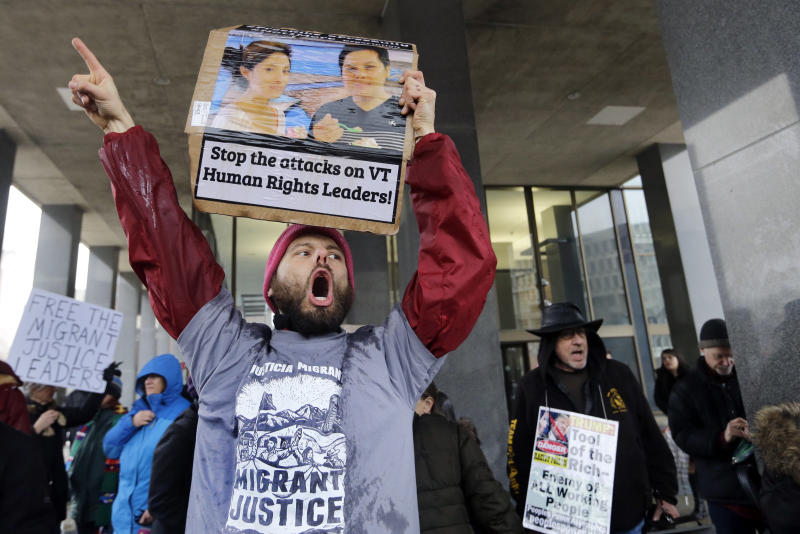 About 100 protest detention of Vermont farm worker advocates