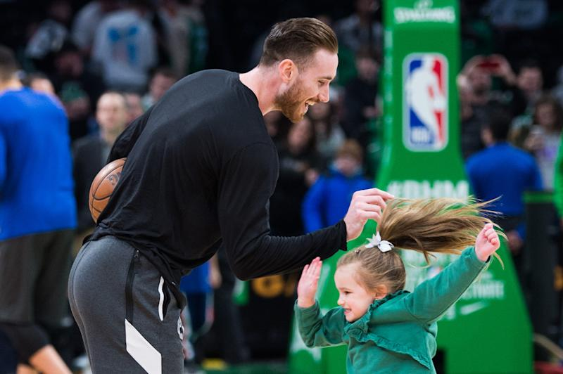 Gordon Hayward #20 of the Boston Celtics plays with his daughter Bernie during warmups prior to the start of the game against the Philadelphia 76ers at TD Garden on February 1, 2020 in Boston, Massachusetts. NOTE TO USER: User expressly acknowledges and agrees that, by downloading and or using this photograph, User is consenting to the terms and conditions of the Getty Images License Agreement. (Photo by Kathryn Riley/Getty Images)