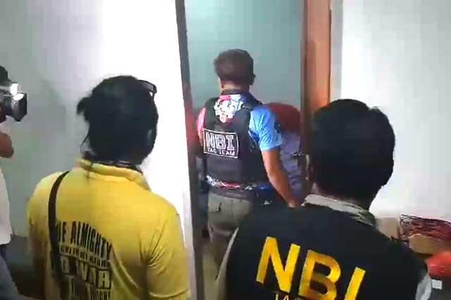 National Bureau of Investigation (NBI) operatives raid a Kapa office following reports of involvement in investment scams