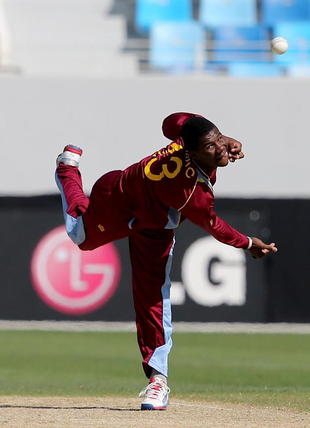 DUBAI, UNITED ARAB EMIRATES - FEBRUARY 14: Ramaal Lewis of the West Indies bowls during the ICC U19 Cricket World Cup 2014 match between South Africa and the West Indies at the Dubai Sports City Cricket Stadium on February 14, 2014 in Dubai, United Arab Emirates. (Photo by Francois Nel - IDI/IDI via Getty Images)