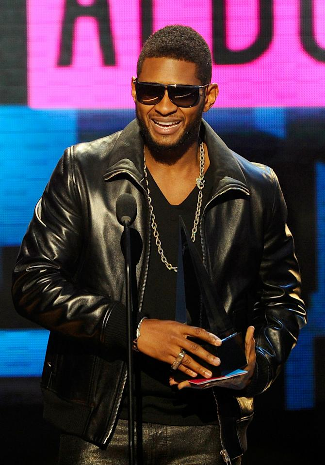 LOS ANGELES, CA - NOVEMBER 21:  Singer Usher accepts the Soul/Rhythm & Blues Music - Favorite Album award for 'Raymond v. Raymond' onstage during the 2010 American Music Awards held at Nokia Theatre L.A. Live on November 21, 2010 in Los Angeles, California.  (Photo by Kevork Djansezian/Getty Images for DCP)